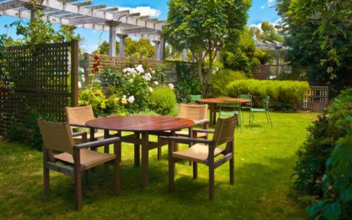 Dining Table set in Lush Landscaped Garden